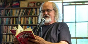 Caption: David Kulczyk reading from California's Deadliest Women at Couth Buzzard Books, Seattle, September 10, 2016.